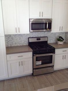 French Gray Quartz Countertop, Herringbone Patterned Marble Baclsplash - Key Elements Studio