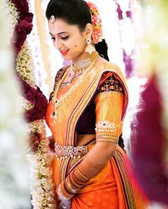 South Indian bride. Diamond Indian bridal jewelry.Temple jewelry. Jhumkis.Orange silk kanchipuram sari.Braid with fresh jasmine flowers. Tamil bride. Telugu bride. Kannada bride. Hindu bride. Malayalee bride.Kerala bride.South Indian wedding.