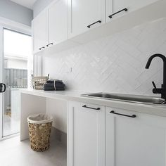 SPLASHBACK A white textured overlay to bring the hamptons to life in the laundry. Also admire the matte black tapware and handles for a a bold yet beautiful contrast. Laundry Room Tile, Laundry Nook, Room Tiles, Small Laundry, Laundry Cabinets, Laundry Cupboard, Laundry Tubs, Laundry Baskets, Laundry Storage