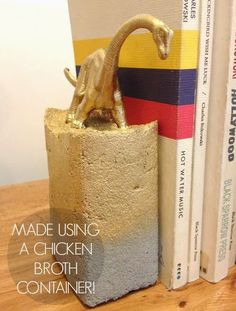 DIY bookends made from cement and toys Like the concept, but I would use a smaller box. Even painted, the cement looks like a big block of cement.