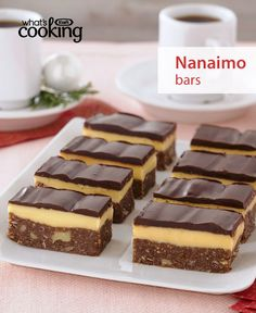 Recipe reviewers call these the easiest and tastiest Nanaimo Bars they've ever made. We can't argue with that. Celebrate our culinary heritage in the most delicious way by whipping up a batch of Nanaimo Bars, THE classic Canadian hand-held dessert. Tap or click photo for #recipe.