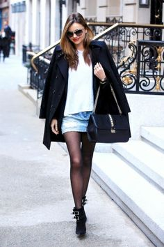 Miranda Kerr in Givenchy coat, Ksubi skirt, and Barbara Bui shoes with Miu Miu sunglasses and Valentino bag.
