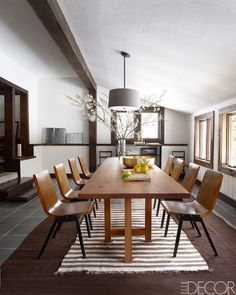 Vintage chairs from R. T. Facts surround a dining table which was made from a cherry tree.