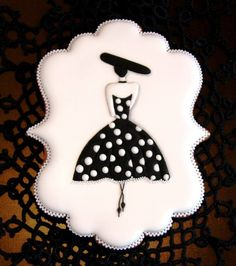 Black and white polka dot dress , hat decorated cookies