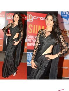 Black Color Crepe Fabric Saree With Embroidered Net Blouse http://www.fabefy.com/black-color-crepe-fabric-saree-with-embroidered-net-blouse.html