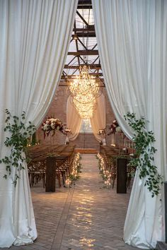 Candles lined the aisle at this elegant and chic wedding at the Bridgeport Art Center which featured dreamy chandeliers hovering over the brick aisle. The reception was complete with rustic rentals and an extraordinary floral arrangement. Rustic Wedding Flowers, Chic Wedding, Wedding Table, Wedding Ideas, Wedding Planning, Wedding Reception Entrance, Barn Wedding Venue, Wedding Ceremony, Wedding Venue Decorations