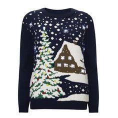Je zoektocht naar de perfecte kersttrui is voorbij. Deze heeft ingebouwde lichtjes in het sneeuwlandschap. Echt waar!