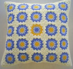 the cornflower granny square crochet cushion by handmadebyria