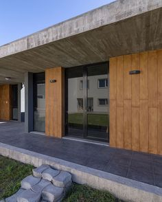 estudio moire encloses atelier gael in light-filled concrete shell Timber Planks, Sawn Timber, Outdoor Dining, Indoor Outdoor, Outdoor Decor, Shell House, Concrete Houses, Exposed Concrete, Roof Lines