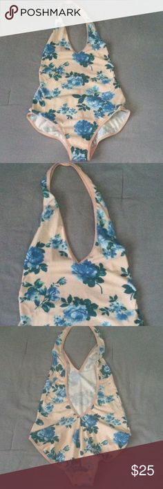 American Apparal floral halter backless bodysuit Excellent condition . Only worn twice . Once by me w/underwear on and the other posher said she only wore it for less than a hour . Perfect paired with some high waisted jeans :) feel free to ask questions . American Apparel Tops
