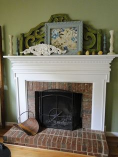 An a thrifty, painted headboard on the mantle.  Like.