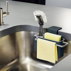 Joseph Joseph Sink Aid In-Sink Caddy – $15 keeps sponges, scrub brushes, & dishcloths out of the sink and allows them to dry