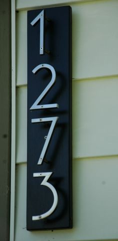 House numbers purchased off the internet then put on a painted board to make them stand out.