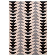 Showcasing an eye-catching triangle motif, this stylish indoor/outdoor rug offers chic appeal to your living room and patio alike.   Pro...