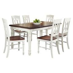 """7-piece wood dining set with a timeless table and 6 double x-back side chairs.  Product: 1 Table and 6 chairsConstruction Material: Hardwood solids, engineered wood and veneersColor: WhiteFeatures: Turned legs18"""" removable leafCarved detailsScooped seats for added comfortDimensions: Table: 30.25'' H x 48.25'' W x 36'' DChair: 38"""" H x 20.75"""" W x 17.75"""" D"""