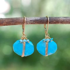 """TURQUOISE GOLD WRAPPED EARRINGS, $49 Turquoise primitive coin nugget earrings gracefully dangle from a 14k gold filled leverback.  Faceted turquoise coin nugget with 3 bead turquoise ruffle Measures approx 1 1/4"""" tip to tip 14k gold filled leverbackTurquoise Gold Wrapped Earrings Wallin & Buerkle"""