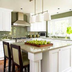I like the idea of a huge island table in the kitchen. Perfect for gathering together while food preps are ongoing.