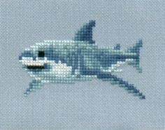 Great White Shark cross stitch chart by 5PrickedFinger5.  Four different (but similar) shark cross stitch patterns available for sale in this Etsy store. This guy is my favourite because it kind of looks like he is smiling :)