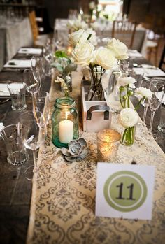 maybe bud vases with baby's breath and mason jars with candles as accents to the main centerpiece