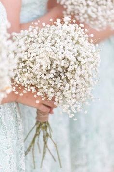 Simple and elegant wedding bouquets. We love baby's breath and think it is SO pretty for any wedding.