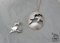 handcrafted and recycled spoon bird on a berry branch brooch