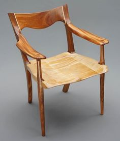 Curly Maple seat and accents Mahogany legs, arms, and backrest