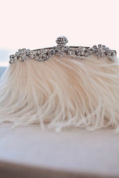 White feathers and crystal clutch. #gatsby #artdeco #wedding