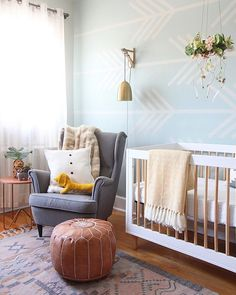 Designing a nursery is so wonderful. I can't help but have a constant grin with so much cuteness surrounding me! For my friend's nursery design, I wanted to add a little greenery by creating a DIY mobile with faux flowers, gold tips feathers, and a wreath frame. I think it adds a breath of fresh air to the room! — Jenni Radosevich, creator of @ISPYDIY #ispydiy #BHGTakeover #BHGHome