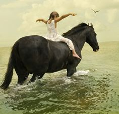Oh my god i wanna be her... To be a little girl, riding bare back, on a horse, in the ocean....