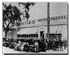 The first motion picture studio in Hollywood was built by the Nestor Motion Picture Company on Sunset and Gower corner. Nestor Studios merged one year later with Universal Film Company.