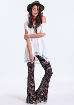 Handmade pull-on style bell bottoms with a paisley and floral pattern in burgundy, white and navy blue. Finished with an elastic waistband and a lightweight fabric. Style these ultra-rad bells wi...