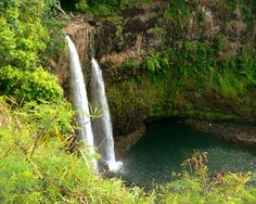 Wailua Falls in Kauai is situated northwest of Hanamaulo along Highway 583. It's found at the southern end of the river. When visiting the falls, one of the other fun things to do is a trip upriver to Fern Grotto. The journey up the historic river takes under an hour and is not something you want to miss. To visit the Fern Grotto visitors can take one of the flat bottom boats that depart every thirty minutes from the south end of river. Many Kauai tours operate herefor a fairly low cost.