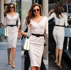 Miranda Kerr looked amazing in this vintage inspired off white dress by Victoria Beckham when she arrived at Vogue in NYC. Personally, the only thing I am not mad about is the full length zip at the back. Just don't think it needed it when the dress is worn with a belt. Accessories are: Prada handbag, Mui Mui sunglasses and Lanvin shoes