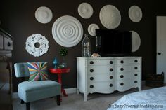 Ceiling medallions on wall, to camouflage the TV