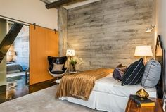 Contemporary Master Bedroom with Hanging rustic door, Horizontal wood plank wall, Standard height, Contemporary chair