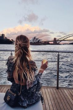Cheers to sunset behind the Opera House and the Harbour Bridge in Sydney I Australia http://www.ohhcouture.com/2017/04/weekly-update-48/ #leoniehanne #ohhcouture
