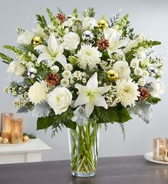 Order Dazzling Winter Wonderland Flower Arrangement flower arrangement from Rambling Rose Florist, your local Hudson, FL florist. Send Dazzling Winter Wonderland Flower Arrangement floral arrangement throughout Hudson and surrounding areas. Winter Floral Arrangements, Large Flower Arrangements, Floral Centerpieces, Christmas Flowers, Winter Flowers, Christmas Wreaths, Christmas Gifts, Fresh Flowers Online, 800 Flowers
