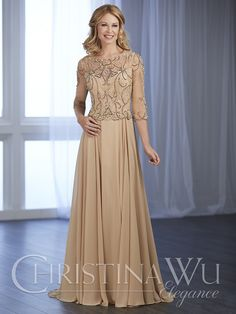 Long chiffon, peplum gown with full-length, illusion sleeves bound in beads and sequins, complemented by a rhinestone encrusted neckline. Zipper back.