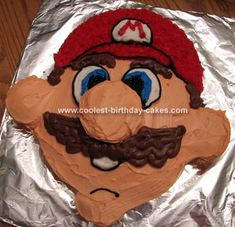 Super Mario Cake: This Super Mario cake was made using 1 package of yellow cake mix, according to the directions.  For baking, I used 2 round pans (8 in.) and a dozen cupcakes.