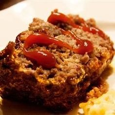 Baked meatloaf with green pepper, onion and steak sauce. Goes great with rice pilaf, glazed carrots and a green salad.