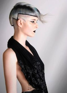 lovely geometrical haircut with the black line, except I would cut the loose hair.