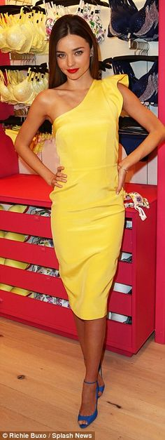 Miranda Kerr shines in a lemon yellow shift dress and bright blue stilettos