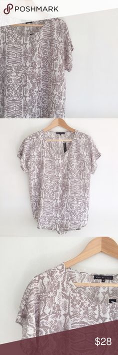 Snake Print Top Gray and white snake print top with short sleeves and slight high-low hem. New with tags. Violet & Claire Tops Tees - Short Sleeve