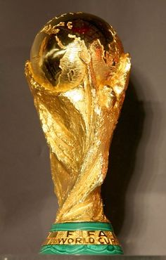 The FIFA World Cup Trophy is made of 18 carat gold. It depicts two people 6f9ec8fb2635e