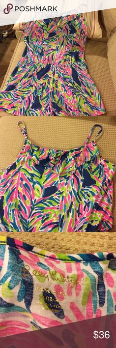 Lilly Pulitzer Palm Reader Romper size xl 12-14 Lilly Pulitzer Palm Reader Romper size xl 12-14.  Beautiful lightweight cotton romper.  Adjustable straps.  Excellent condition Lilly Pulitzer Bottoms Jumpsuits & Rompers