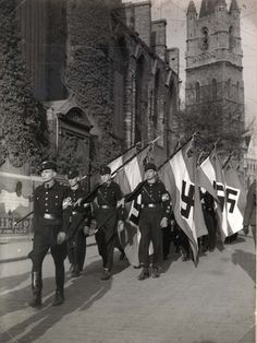 Flemish Hitler Jugend on parade with flags. Ghent, Belgium.