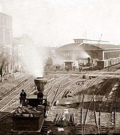 This is an unusual picture of Atlanta, Georgia, taken in 1864. You can see a period locomotive, and what looks like a depot in the background.