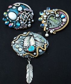 Tried my hand at jewelry today and this is the first group I finished! Polymer clay and sterling silver, glass cabochons, crystals and rhinestones. Let me know what you think! I'll post individual ...