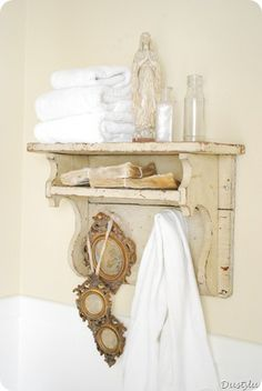 Love the antique mirror trio (purchased at Dan Marty Designs) hanging from this shelf.