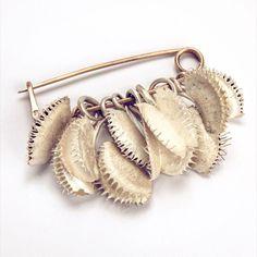 The lure of Venus, brooch, silver and shibu-ishi. Cast Venus fly traps.